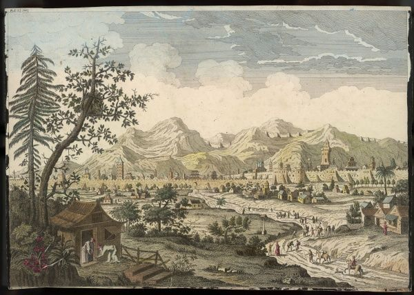 General view of the city, with travelers approaching on a country road