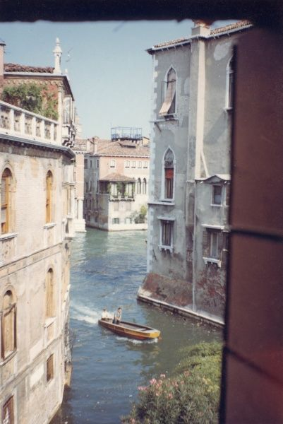 View of a canal through a window in Venice, Italy. Date: 1968