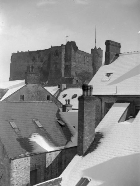 View of the Castle across the rooftops, from a building in the High Street, Haverfordwest, Pembrokeshire, Dyfed, South Wales. There has been a recent fall of snow. The castle dates back to the 12th century