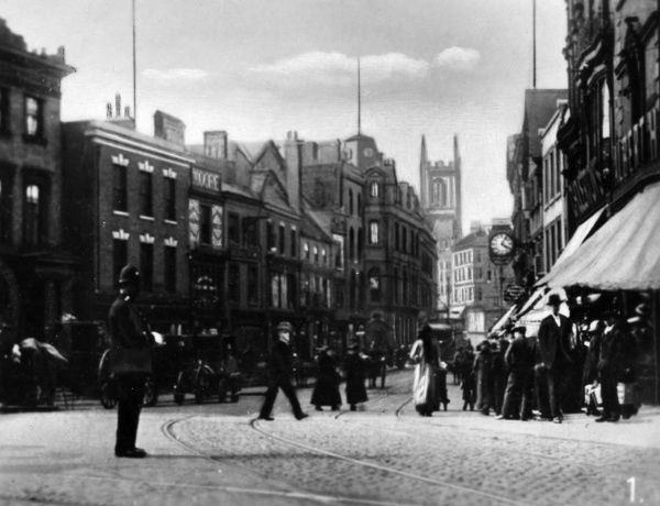 View of the Cornmarket in the town centre, Derby -- it is one of the main streets, named after an actual corn market which took place there. Date: circa 1910