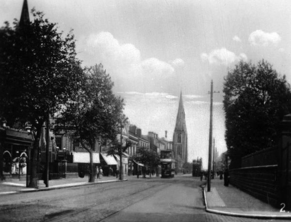 View of London Road, Derby, with two trams and a church spire. Date: circa 1910
