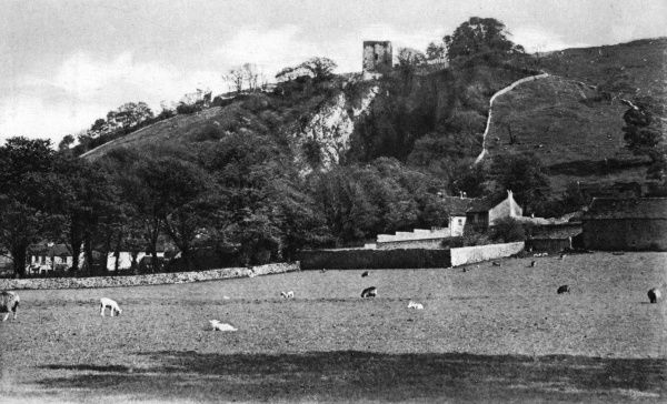 View of Peveril Castle, an ancient monument and Grade I listed building overlooking the village of Castleton, Derbyshire. Date: circa 1920