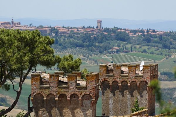 Italy, Tuscany, Province of Siena, Monticchiello: Castle towers, view towards Pienza Date: 2010