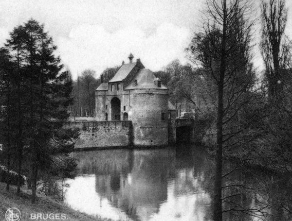 View of the Porte Marechale, or Smedenpoort (Smeden or Forge Gate), one of the gates of the city of Bruges (Brugge), Belgium. Date: circa 1920