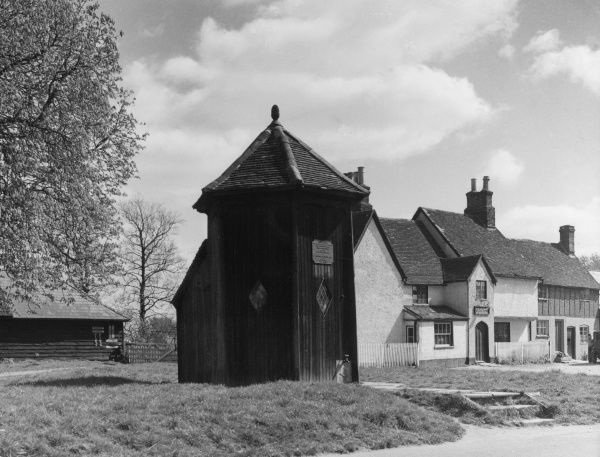 This odd-shaped building on the village green at Offley, Hertfordshire, England is a well house, within which is 'modern' pumping machinery providing water 'on tap'. Date: 1930s
