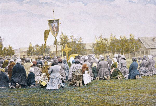 Procession with banners in a Russian village