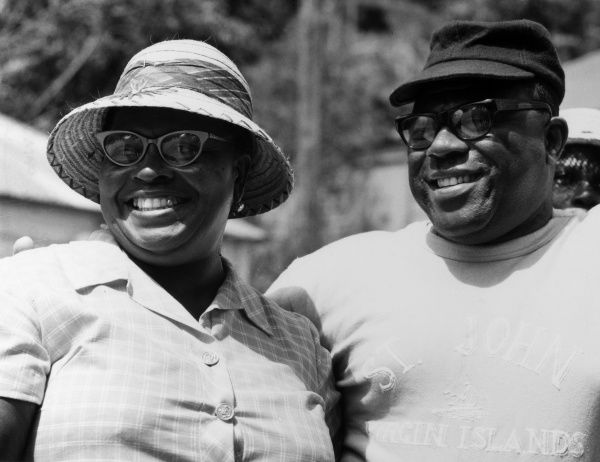 A jolly-looking middle aged couple of West Indian Virgin Islanders at the market on Tortola, Virgin Islands, West Indies. Date: late 1960s
