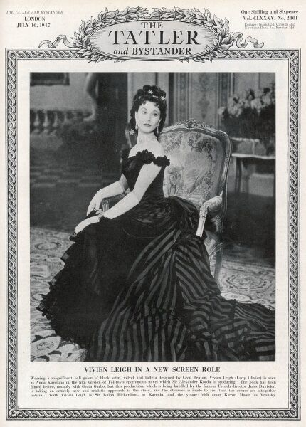 Vivien Leigh pictured on the front cover of The Tatler wearing a magnificent ball gown of black satin, velvet and taffeta designed by Cecil Beaton for her film role of Anna Karenina