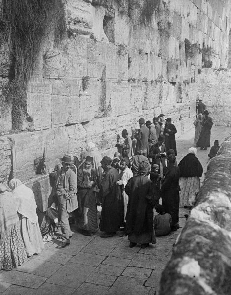 A view of the Western Wall, Jerusalem, the only surviving outer wall of Solomon's Temple. Heartfelt weeping Jewish prayers caused it to be known as the 'Wailing Wall'. Date: early 1930s