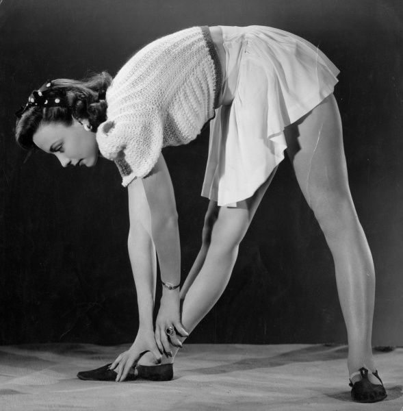 An exercise designed to trim your waist and tone your thighs. Date: late 1930s