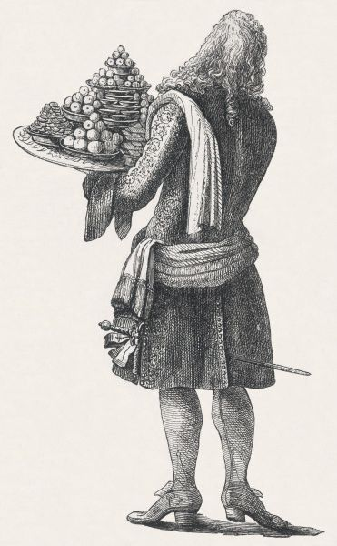 Back view of a French waiter carrying a round tray laden with pastries and sweetmeats at a court ball during the reign of Louis XIV
