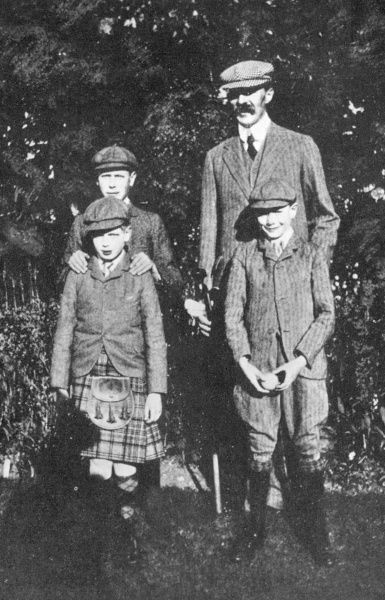 Prince Albert of Wales (the future King George VI), standing behind, Prince George of Wales, later Duke of Kent (in kilt)and Prince Henry of Wales (later Duke of Gloucester) pictured with their tutor, Mr Hansell, in 1910
