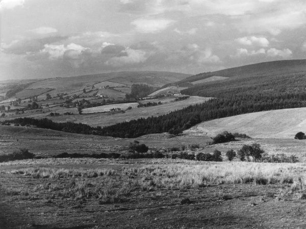 A view looking across Wales from the 'Anchor Inn', at the head of the Clun Valley, in South West Shropshire. Date: 1930s