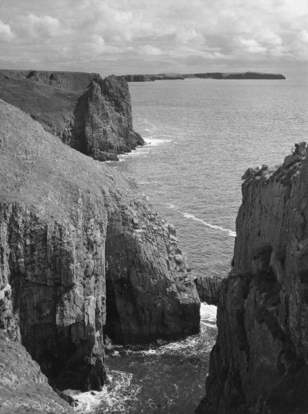 Lydstep Point, Pembrokeshire, Wales.. This fine headland, with its magnificent limestone cliffs, forms part of the National Park. Caldey Island is in the distance. Date: 1950s