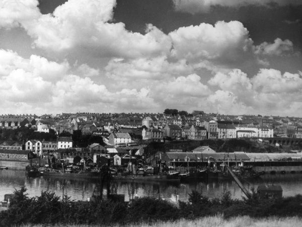 The harbour and part of the town of Milford Haven, Pembrokeshire, Wales. Date: 1950s