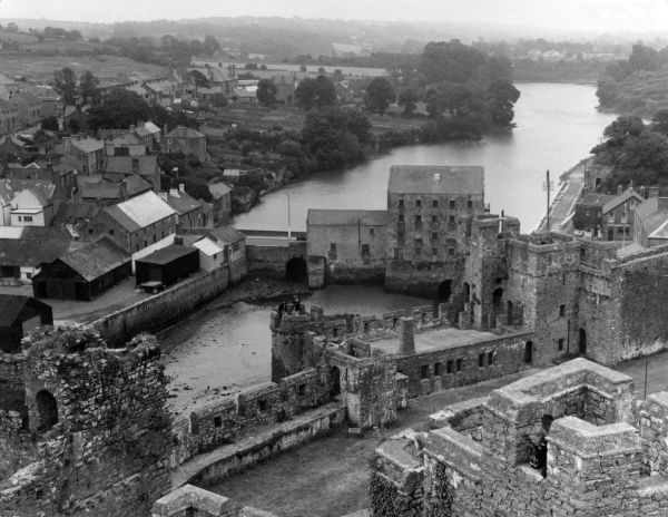 The harbour wall and fortifications of Pembroke, Pembrokeshire, Wales, as seen from the ancient castle. Date: 1950s