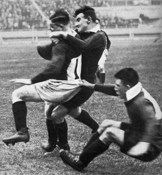 The Australians using rather brutal tactics to overcome the Welsh side at the first rugby league match to be played at Wembley stadium in January 1930. Date: 1930