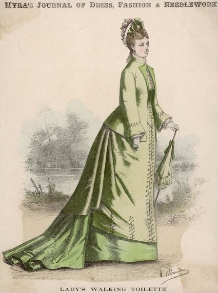 A green jacket bodice worn open to reveal a waistcoat & worn with a double skirt - the trained under skirt and revers in a deeper shade. Eyelets & lacing are used as ornament