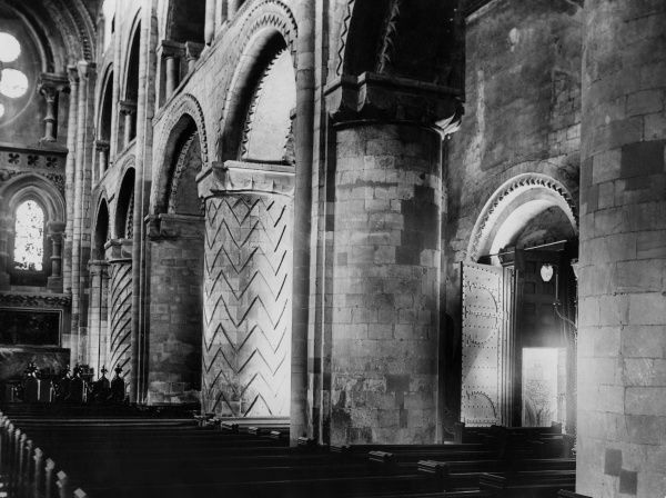 The original Nave of Waltham Abbey, Essex, England. On the right is the Norman south doorway and the door, with its curious crescent-shaped hinges. Date: 11th century