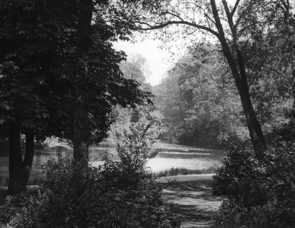 A picturesque view of the lake at Wanstead Park, Essex, England. Date: 1930s