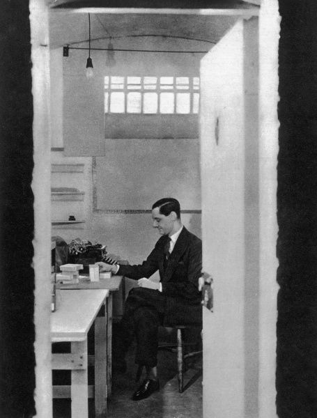 A War Office filing clerk in his temporary office, a cell at the Wormwood Scrubs prison in west London. The prison was requisitioned by the War Office at the outbreak of war in 1939