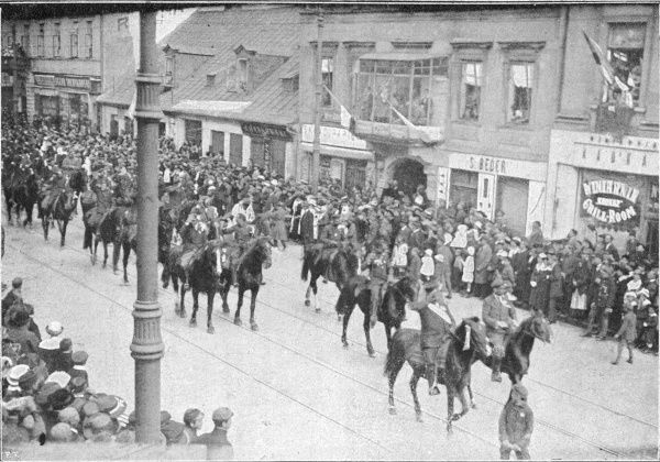 When Bolshevik Russia attempts to seize Poland, the Poles fight for their independence with patriotic fervour : Polish cavalry in the streets of Warsaw