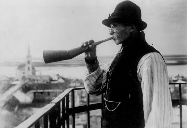 A watchman at Kunszentmiklos, Hungary, blowing his horn during times of danger due to serious flooding over 200,000 acres of low-lying acres of arable and meadow land. Date: 1930s