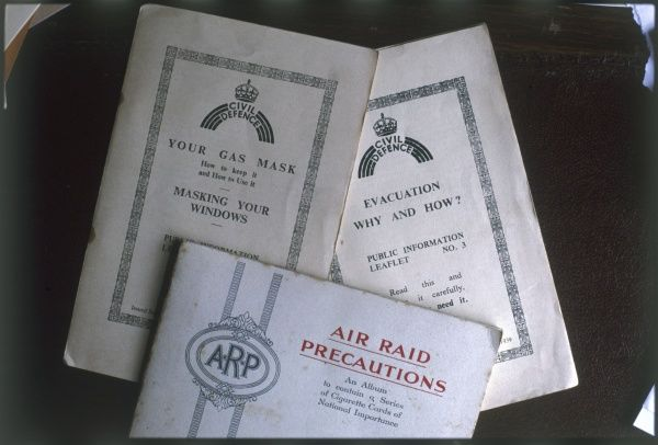 Three public information leaflets, issued in Britain during World War Two, 'Air Raid Precautions', 'Your Gas Mask' and 'Evacuation: Why and How&#39