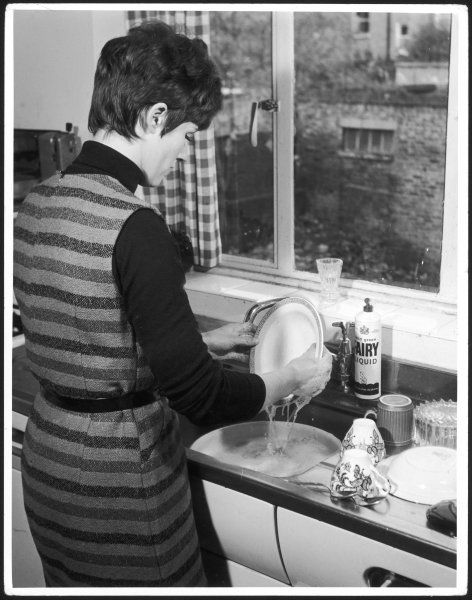 A fashionable lady does the washing up