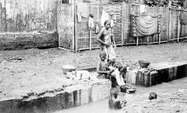 Washing day in Java, Dutch East Indies. Date: 1930s