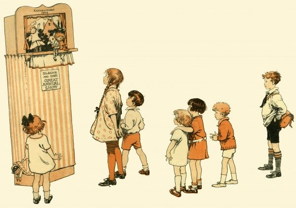 Girls and boys gather round to watch a puppet show 1904