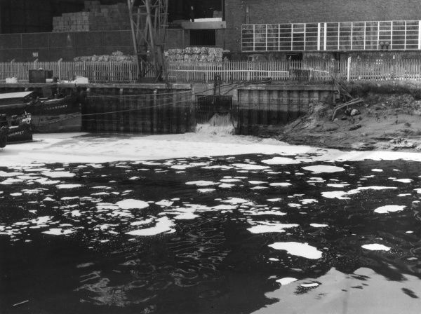 Water pollution from factory waste, River Mersey, Warrington, Cheshire, England. Date: 1960s