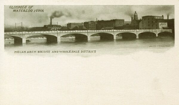Waterloo, Iowa - USA - The Melan Arch Bridge and the Wholesale District. Date: circa 1910s