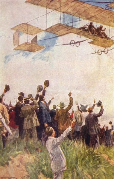 A crowd of people wave to a plane as it flies overhead in the course of circumnavigating the globe in seven days... Date: 1910