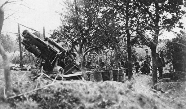 A photograph of British howitzers in action during the bombardment of the German lines preceding the beginning of the Battle of the Somme on July 1st 1916. Intended to be a decisive breakthrough, the Battle of the Somme instead became a futile