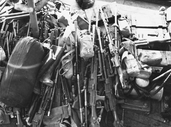 Bren guns and others piled on the decks of the Royal Sovereign during the evacuation of the British Expeditionary Force from Cherbourg en route for Southampton