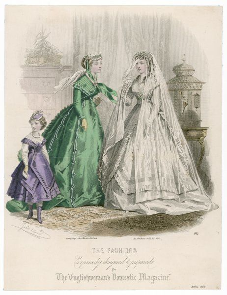 Dress with tight sleeves, a trained double skirt - the over-skirt overlaps at the front & is bordered with a flounce & rows of flat trim. The veil is extremely long