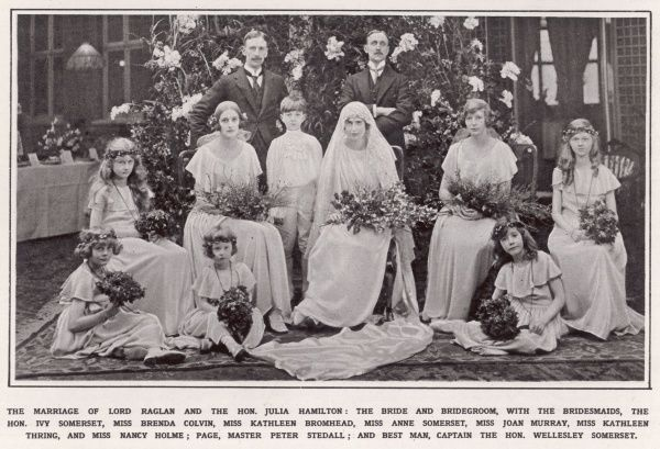Wedding photograph for the marriage of Fitzroy Richard Somerset, 4th Baron Raglan (1885-1964) to the Hon. Julia Hamilton (1901-1971). They are surrounded by bridesmaids and the best man, Captain the Hon. Wellesley Somerset
