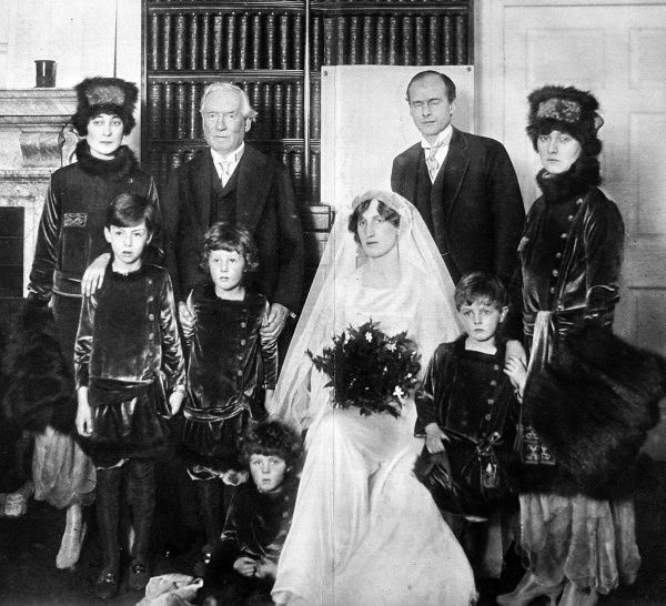 Photograph showing the wedding party of Violet Asquith (centre) and Maurice Bonham Carter (top right), 30 November 1915. The other figures are (back row, left to right): Kathleen Tennant, H.H. Asquith, Elizabeth Asquith. Front row, left to right