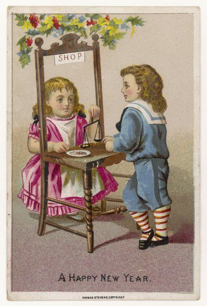 Children playing shops: the girl is weighing something out for the boy to buy