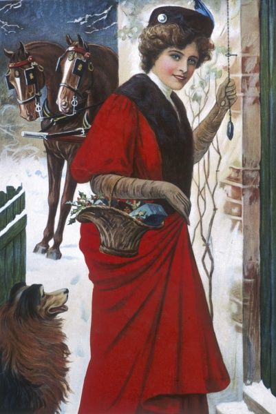 A jolly young woman rings on the doorbell of a house at Christmas time armed with a basket of festive food and gifts