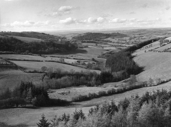 The rolling Welsh landscape near Kerry, Montgomeryshire, Wales. Date: 1960s