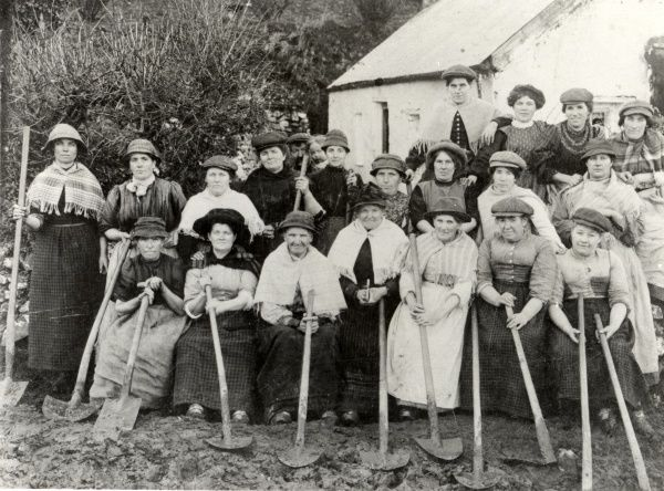A group of twenty Welsh women road builders in Pembrokeshire, Dyfed, South Wales, holding their spades