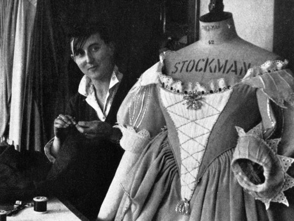 Wendy North, a Chichester girl, a seamstress in the Chichester Festival Theatre's wardrobe department. On the dummy is one of Joan Plowright's costumes. Date: 1962