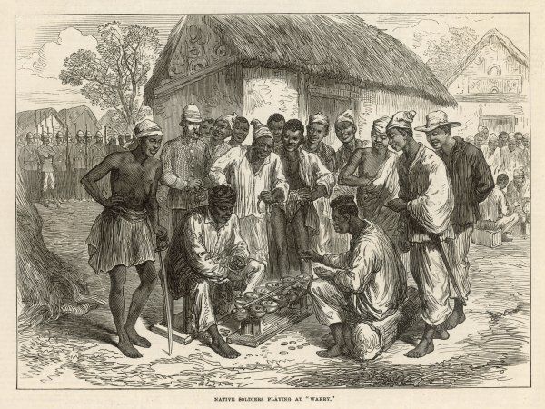A crowd gathers to watch two people play the West African game of 'wharri&#39