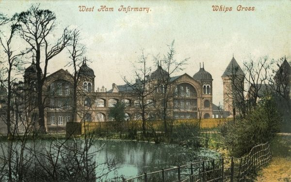 West Ham Infirmary, Whipps Cross, Leytonstone, Essex, viewed across a small lake. The infirmary, better known as Whipps Cross Hospital, was opened in 1903 by the West Ham Union for the sick poor in the area