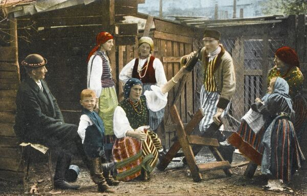 Family from the Baltic Region - Far Western Russia at this period - passing round a bottle of Kumis