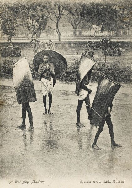 A wet day in Madras, India. The local population use a variety of different methods to keep the rain off their heads!