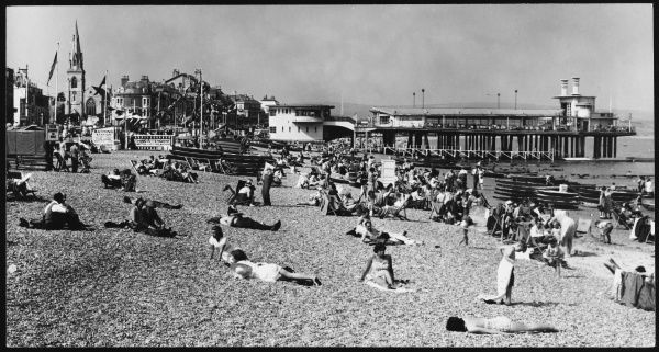 Holidaymakers on the beach at Weymouth in Dorset