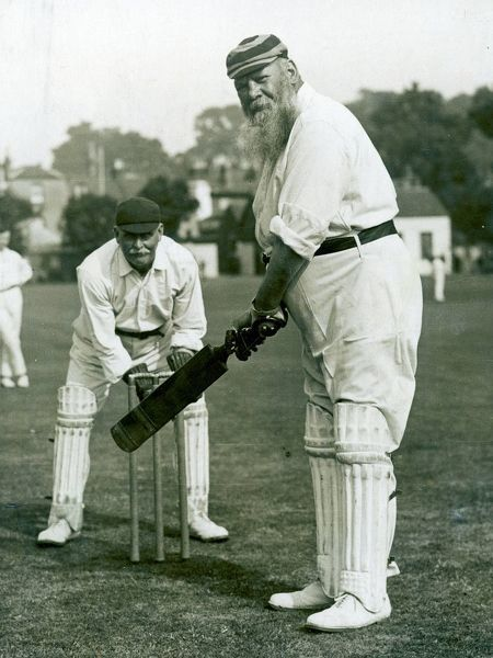 Photograph of Dr. William Gilbert Grace (1848-1915) batting in the Gravesend vs. Eltham cricket match, held at Gravesend cricket ground, 1913. Grace was arguably the finest cricketer of his era, scoring 126 first-class centuries and taking 2876 wickets